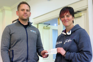 Lee Barnfield (L) presents Liz with a cheque for £150 from Team Smells like Toast's sponsored cycle ride topped up by our Club